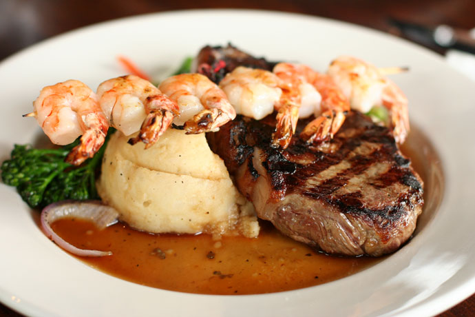 10oz New York Steak with Bistro Prawns