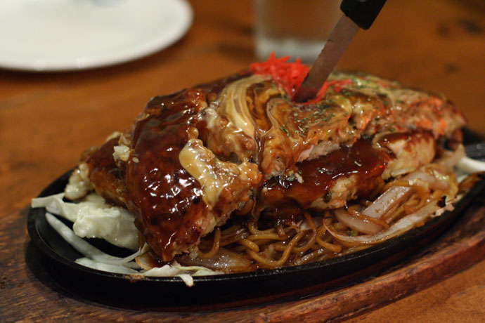 Mixed Seafood Okonomiyaki Japanese pizza served on Yakisoba noodles ($16.50) from Clubhouse Restaurant in Vancouver.