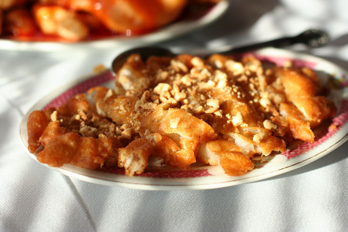 Breaded chicken with peanuts