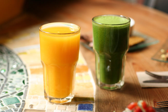 Fresh orange juice ($5.25) and Green Glory drink ($5.50) from Gorilla Foods in Vancouver.