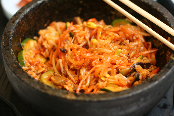 Korean Bibimbap dish after mixing the ingredients in the hot stone bowl.