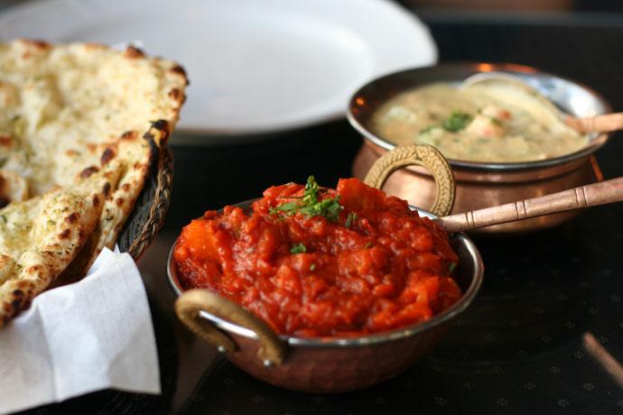 Indian food from Indian Oven restaurant in Vancouver: Garlic Naan bread ($2.25), Bombay Aloo ($10.95), Vegetable Korma ($10.95)