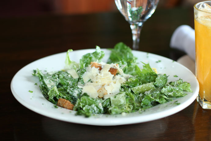 Caesar salad at the Keg Steakhouse on Granville Island in Vancouver BC Canada.