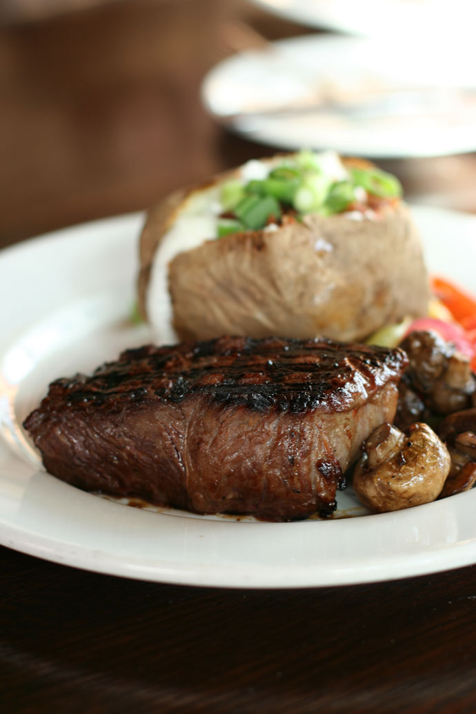 Teriyaki Sirloin steak (medium rare) with Baked Potato and vegetables from the Keg Steakhouse in Vancouver. ($24.95 including Caesar salad)