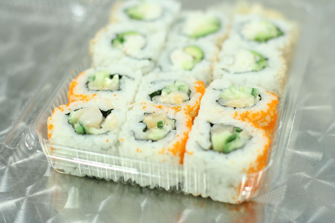 Chopped scallop roll and California roll sushi