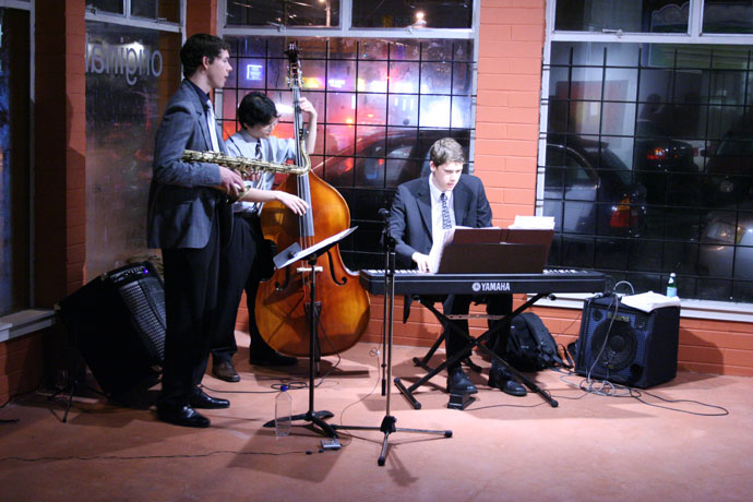 Evan Arntzen, Jason Cho, and Geoff Peters playing jazz