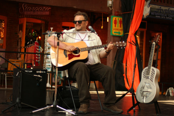 Bill Johnson, blues guitarist, performing at Market Square in Victoria