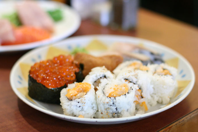 Ikura sushi ($1.95 each) and chopped scallop roll ($3.90)