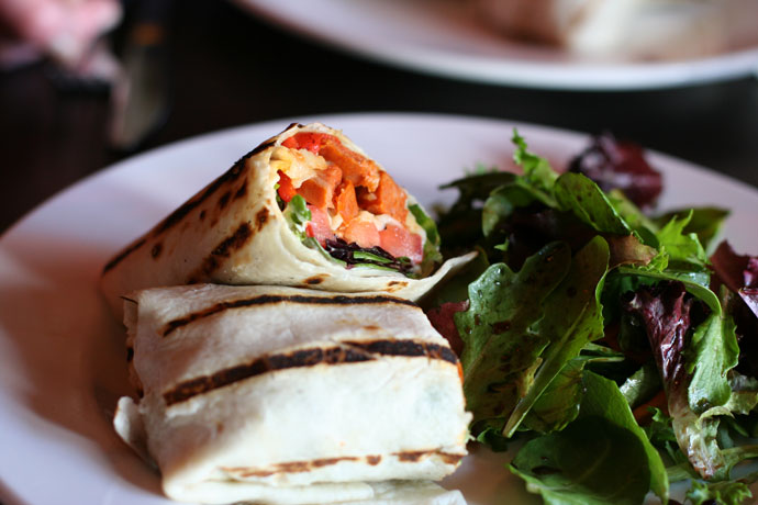 Chorizo sausage wrap and organic salad