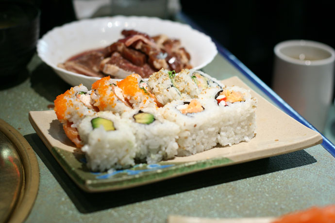 Meat for barbecuing (cook at your table), and sushi: Alaska roll, and Avocado Roll from Shabusen Restaurant in Vancouver.