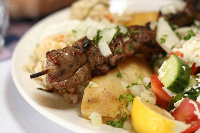 A closeup shot of the Lamb Souvlaki from Simpatico Greek Restaurant in Kitsilano, Vancouver.
