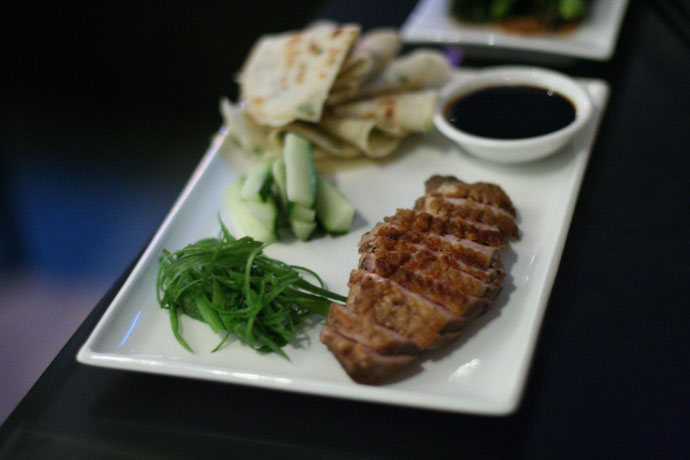 Peking style duck pancakes from Wild Rice restaurant in Vancouver. Made with Yarrow Meadows duck breast, scallion pancakes, and hoisin $18