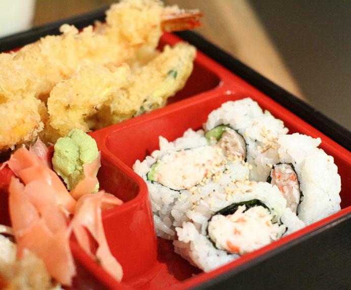 Japanese Bento Box, California roll sushi and prawn and yam tempura.