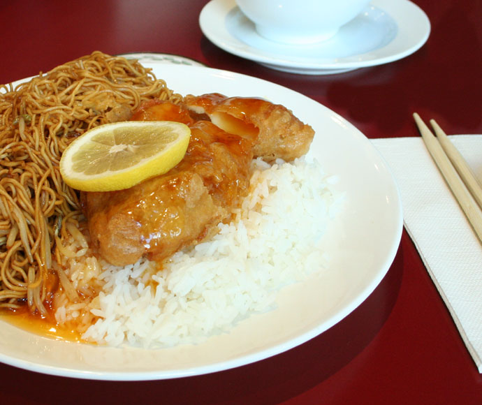 Chinese food: shredded pork chow mein and lemon chicken on rice