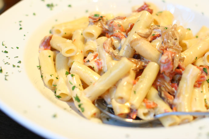 Italian pasta with salmon from Anduccis Pub restaurant in downtown Vancouver, BC, Canada.