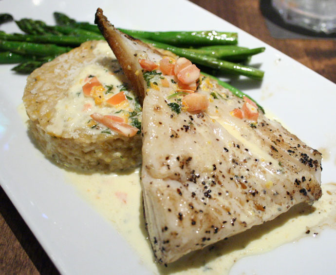 Pan Seared Halibut and Citrus Risotto Cake served with Asparagus