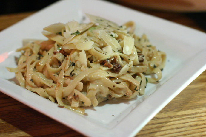 Carbonara fettuccini pasta from Capone's restaurant and Live Jazz Club in Vancouver BC Canada.