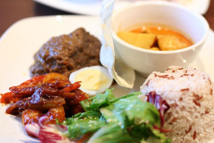 Nasi Jambori from Jonker Street Malaysian Restaurant - Sampler of chicken curry, beef rendang, prawn sambal on a platter with egg, side salad, pappadum cracker & jambori rice. $14.90