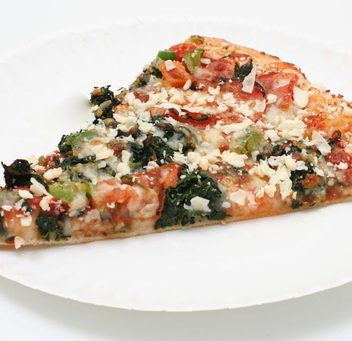 Vegetarian pizza slice from Megabite pizza in Vancouver.