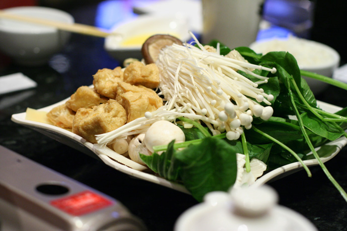 Vegetarian hot pot ingredients from Posh in Vancouver. Mushrooms, spinach, tofu.