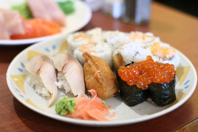 Saba nigiri sushi (Mackerel, $0.99 each), Inari sushi (sweet bean curd wrapper, $0.99) and Ikura sushi.