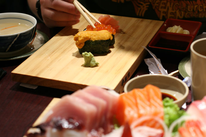 Uni sushi (sea urchin, $2.50), Ikura sushi (salmon roe, $1.80), Sashimi ($13.95) from Sushi Town restaurant in Burnaby, BC, Canada.