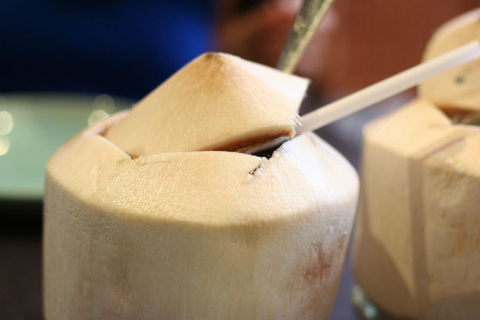 Coconut Juice served in a fresh real coconut (around $4.00) from Tropika Malaysian and Thai restaurant in Vancouver BC Canada.