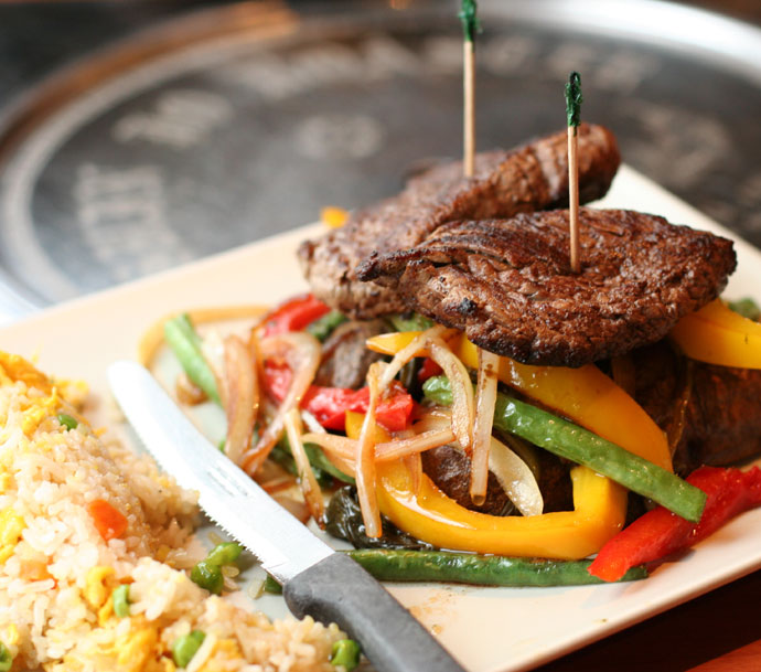 Beef Tenderloin at Wild Ginger (with egg fried rice, potatoes, and stir fried vegetables, around $18)