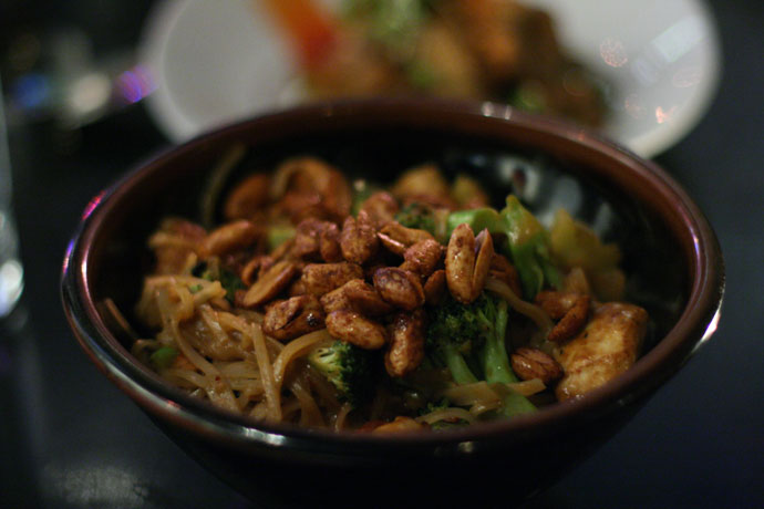 Spicy kung po chicken with twice cooked peanuts from Wild Rice restaurant in Vancouver. Made with Maple Hill free range chicken, broccoli, and rice noodles $18