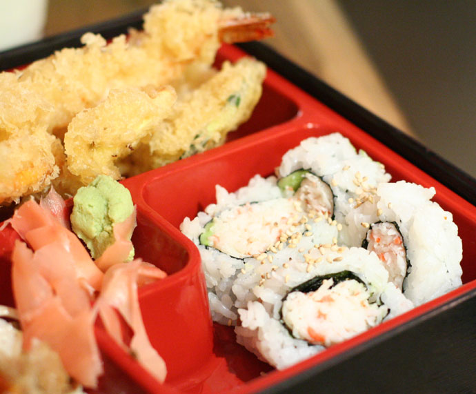 Japanese Bento Box, California roll sushi and prawn and yam tempura.